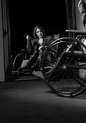 Women-posing-in-vintage-wheelchairs