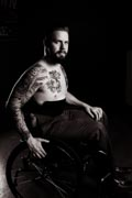 Studio-shot-of-tatooed-man-using-wheelchair