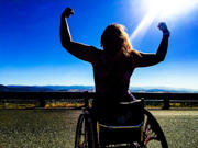 Young-woman-in-wheelchair-silhouetted-against-the-sun