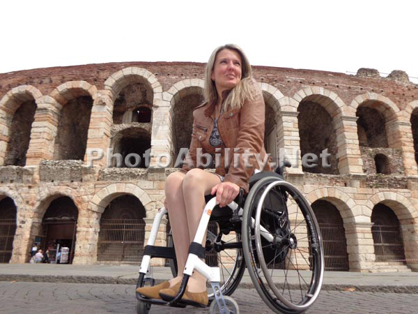 Young woman traveler using a wheelchair touring Italy