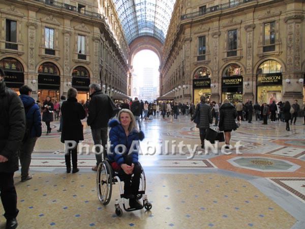 Woman traveler using a wheelchair in Milan Italy