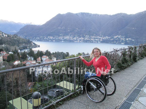 Woman tourist using a wheelchair overlooking Lake Como, Italy