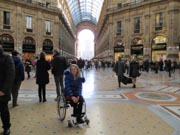 Woman-traveler-using-wheelchair-in-Milan-Italy