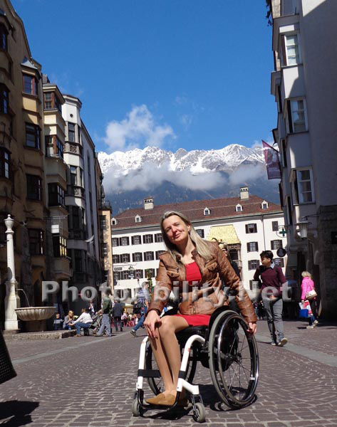 Woman tourist using a wheelchair in Innsbruck, Austria