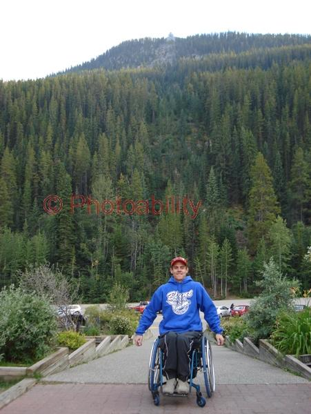 Young man in a wheelchair touring the Canadian Rockies