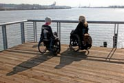 Two-women-in-wheelchairs-enjoying-day-out-in-Vancouver