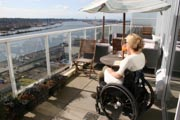 Woman-in-wheelchair-enjoying-the-view-from-her-balcony