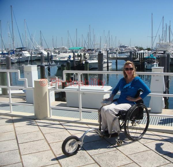 Woman in a wheelchair at the Coconut Grove Marina