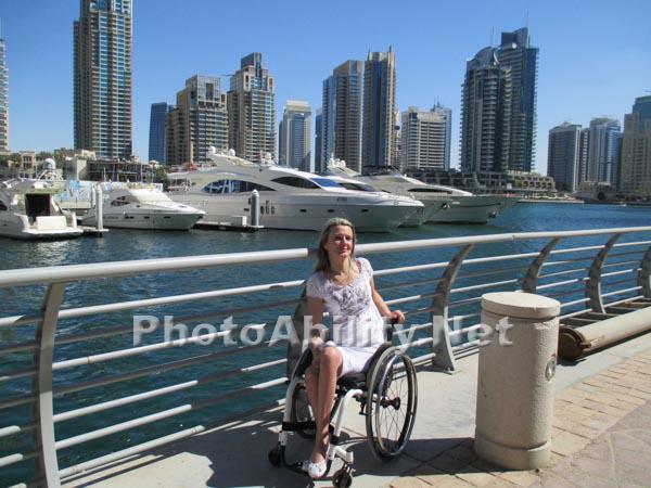 Young woman traveler using a wheelchair visiting Dubai
