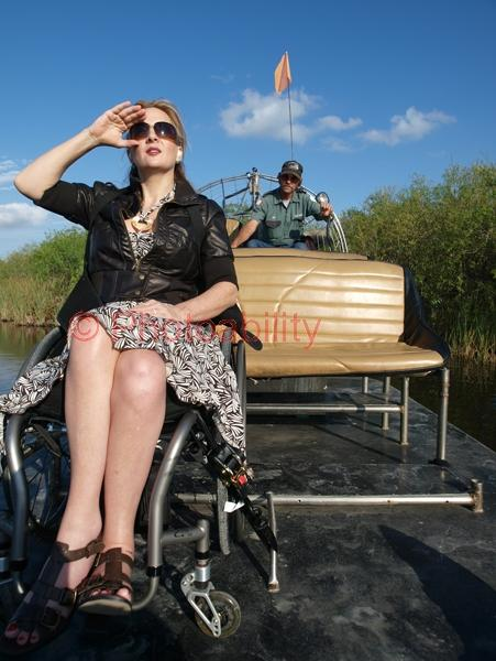 Woman in a wheelchair on an accessible airboat in the Florida Everglades