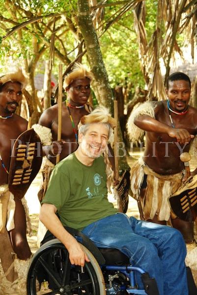Scott Rains with Zulu dancers at a traditional Zulu village in Kwazulu-Natal