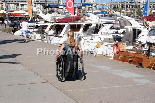 Woman tourist on a coastal harbor promenade