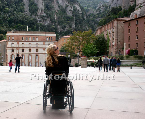 Woman tourist in a wheelchair at the Monastery of Montserrat
