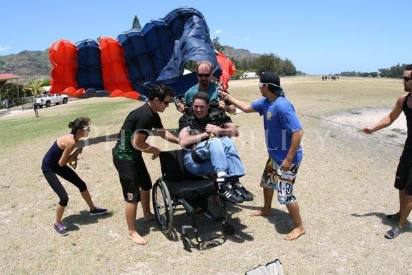 Man in his wheelchair after his parachute jump