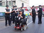 Woman-in-wheelchair-with-London-police