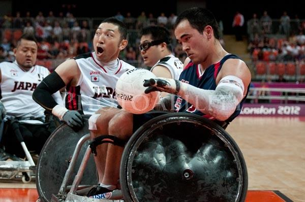 CHUCK AOKI (USA-5) takes KAZUHIKO KANNO (JPN-6) by surprise and out maneuvers for a goal in the men's wheelchair rugby bronze game at the 2012 Paralympic Games.