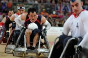 CHUCK-AOKI-USA-runs-the-ball-down-court-while-being-pursuit-by-AARON-PHIPPS-GBR-and-blocked-by-DAVID-ANTHONY-GBR-4.-at-the-preliminary-wheelchair-rugby-game-with-Great-Britian-at-the-2012-London-Paralympics.