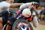 CHUCK-AOKI-USA-is-blocked-by-opposing-team-Great-Britian-during-the-preliminary-wheelchair-rugby-game-at-the-2012-London-Paralympics.
