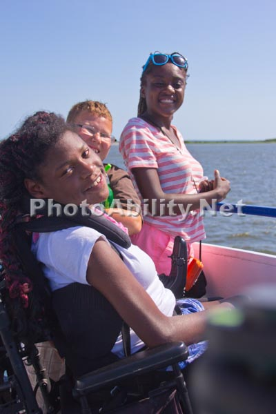 Young girl in a wheelchair with her family fishing