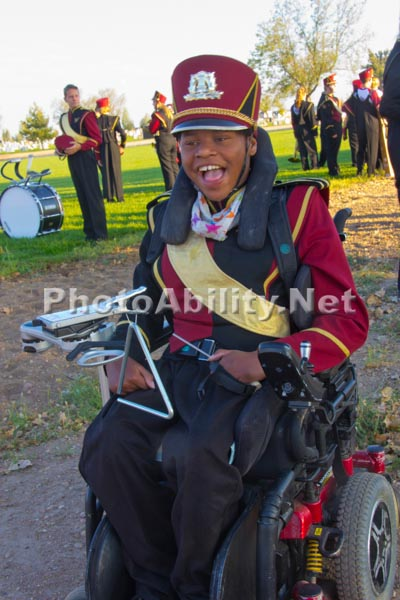 Boy in a wheelchair in a marching band