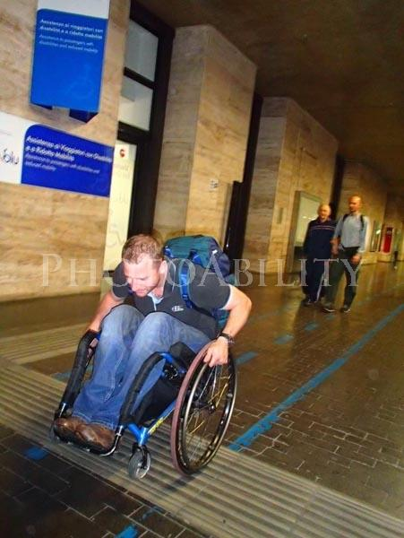 A university student using a wheelchair hurting to class