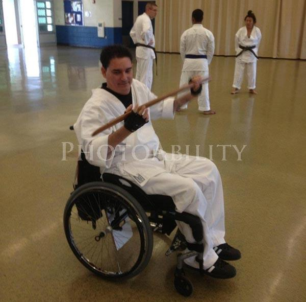 Karate Bokken demonstrated by a man in a wheelchair - wooden sword