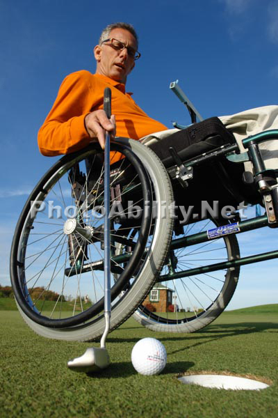 Man in a wheelchair playing golf