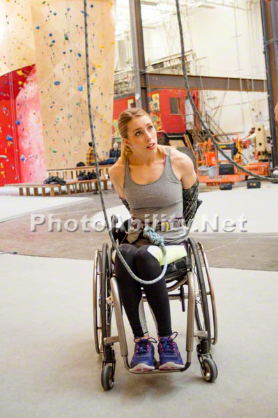Young woman in a wheelchair at an indoor climbing centre