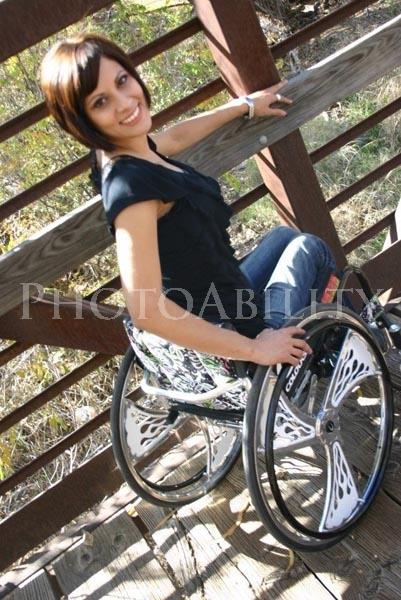 Young woman in a wheelchair on an historic bridge