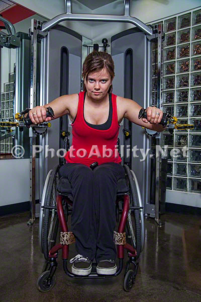 Young woman exercising at a gym