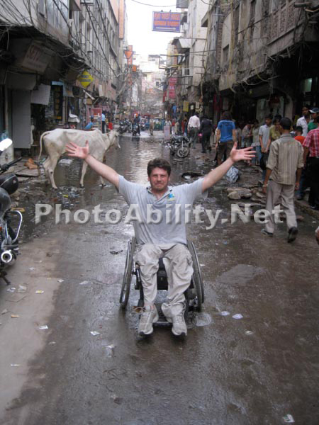 Man in a wheelchair in downtown Delhi