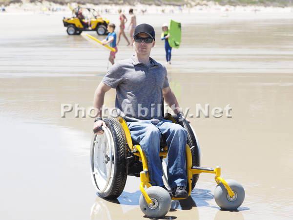 Self propelled beach wheelchair
