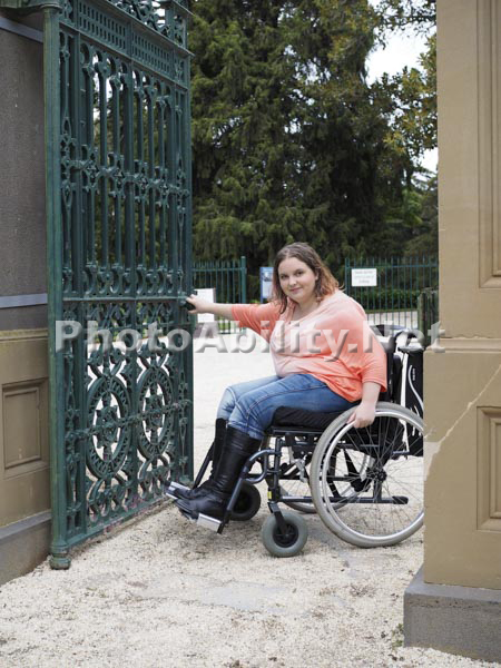 Young woman using a wheelchair exploring the historic Werribee Mansion