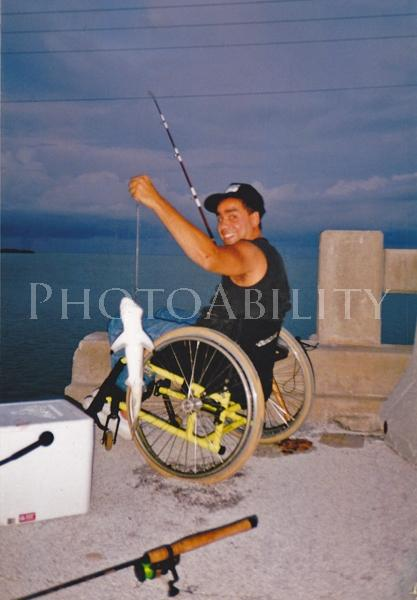 Man in a wheelchair catches his first shark