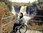 Young-woman-in-wheelchair-at-waterfall-viewing-platform