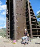 Young-woman-in-wheelchair-at-rock-climbing-wall