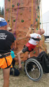man-using-wheelchair-adaptive-rock-climbing