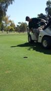 Man-playing-golf-using-an-adaptive-golf-cart