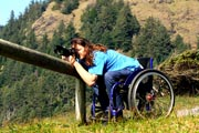 Man-using-wheelchair-taking-pictures-in-National-Park