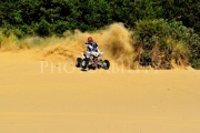 Young-man-on-quad-bike-in-the-sand-dunes