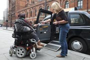 Female-tourist-in-London-using-power-wheelchair