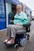 Portrait-of-woman-wheelchair-with-tram-in-the-background,