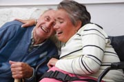 Wheelchair-user-with-Spina-Bifida-laughing-with-and-embracing-her-father.