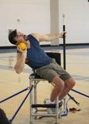 Disabled-athelete-throwing-shot-put