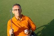 Man-in-wheelchair-playing-golf