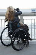 Woman-in-wheelchair-taking-photos-from-an-ocean-observation-deck
