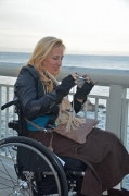 Woman-in-wheelchair-taking-pictures-of-the-Pacific-Ocean