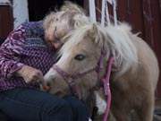 Mature-woman-in-wheelchair-with-her-pony