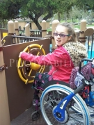 disability;disabled;girl;female;woman;service-dog;access;accessibility;adaptive;lifestyle;leisure;family;wheelchair;play;play-ground;fun