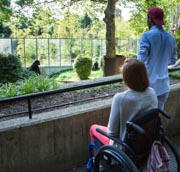 Young-woman-in-wheelchair-with-her-friends-on-day-out-at-the-Zoo